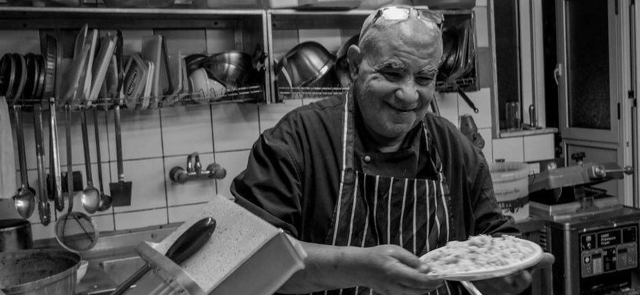 Refugee Week - man cooking in the kitchen