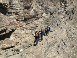 Innes family scaling a rock face for their community fundraising challenge