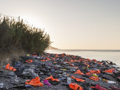 Discarded lifejackets and boat parts on Lesvos beach