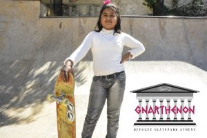 Young refugee with her skateboard at FMS, Athens