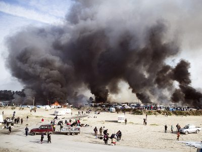 The demolition of the Calais Jungle, October 2016. Hundreds of lone children applied for relocation under the Dubs Amendment; only few were accepted.