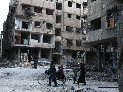 A family walk through besieged Eastern Ghouta