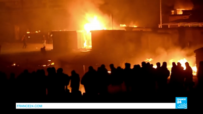 France_ Migrant camp reduced to 'ashes' after huge fire.mp4.00_00_05_13.Still001