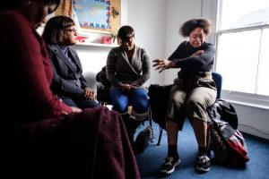 Stephanie Tonmi (R), a former detainee at Yarl's Wood tells Shadow Home Secretary Diane Abbot about her time in detention. Photo: Getty
