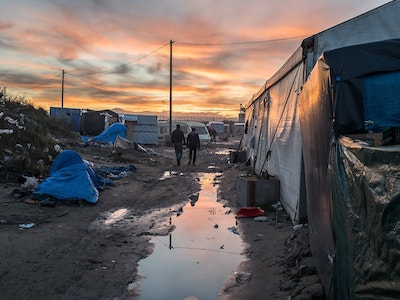 sunset over calais jungle