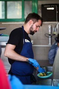 Merlin chef cooking in One Happy Family Community Centre on Greek island of Lesvos