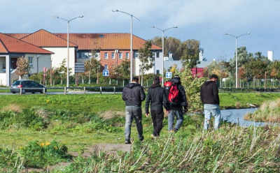 Refugees walking in Calais town