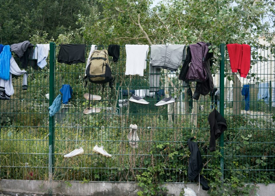 Distributed clothes hand on the fence to dry